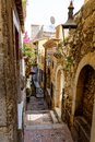 Beautiful old buildings, streets, stairs and alley ways in the town of Taormina, Cantania, Sicily, Italy Royalty Free Stock Photo