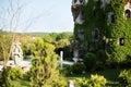 Beautiful old fairy-tale castle near Burgas, Bulgaria. Walls of the castle, green flower garden Royalty Free Stock Photo
