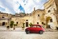 Beautiful old Italian scene. Vintage red small car.
