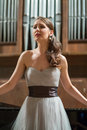 Beautiful opera singer sings emotionally in the concert hall Royalty Free Stock Image