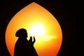 Beautiful orange silhouette of muslim praying at mosque Royalty Free Stock Photo
