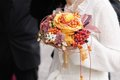Beautiful orange wedding bouquet bride holding flowers Stock Photo