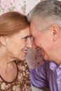 A beautiful pair of older people sitting together Stock Photo