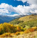 Beautiful panorama mountain landscape with blue sky and white cl Royalty Free Stock Photo