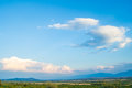 Beautiful panoramic view of green mountains and blue sky with white clouds Royalty Free Stock Photo