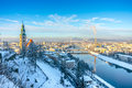 Beautiful panoramic view of Salzburg skyline with Muellner Church and river Salzach in winter, Salzburger Land, Austria Royalty Free Stock Photo