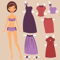 Beautiful paper doll with elegant clothing Stock Photos