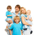 Beautiful parents cute kids happy young family with holding and looking at camera Stock Image