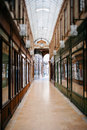 Beautiful parisian shopping gallery tilt shift lens used to accent the path to the entrance and to emphasize the attention it Royalty Free Stock Photo