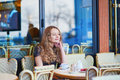 Beautiful Parisian woman in cafe Royalty Free Stock Photo