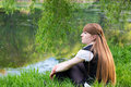 Beautiful park relaxing woman Fotografering för Bildbyråer