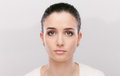 Beautiful pensive woman looking at camera with sad expression Stock Photography