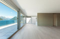 Beautiful penthouse interior modern empty living room with large windows Royalty Free Stock Images