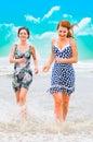 Beautiful people running at ocean Stock Images