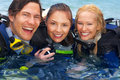 Beautiful people scuba diving Royalty Free Stock Images