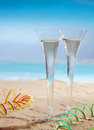 Beautiful photo of glasses of champagne composition on the beach Royalty Free Stock Photos