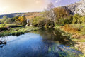 Beautiful picturesque autumn landscape of river in the mountain calm with sunset sky Stock Photo