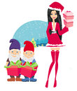 Beautiful pin up girl in christmas inspired costume and dwarfs helpers Royalty Free Stock Photography