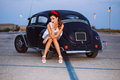 Beautiful pin-up girl posing with hot road car Royalty Free Stock Photo