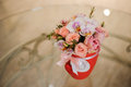 Beautiful pink bouquet of mixed flowers in basket on table Royalty Free Stock Photo