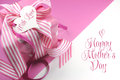 Beautiful pink gift on pink and white background with sample text and copy space for your text here for mothers day international Stock Images