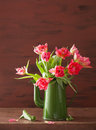 Beautiful pink tulip flowers bouquet in green teapot Royalty Free Stock Photos