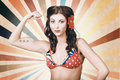 Beautiful pinup girl flexing muscle womens rights vintage photo of with american star tattoo showing the power of when muscles in Stock Images