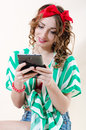 Beautiful pinup woman holding tablet pc computer happy smiling over white background Stock Photos