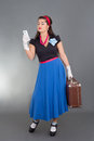 Beautiful pinup woman retro suitcase cellphone Royalty Free Stock Image