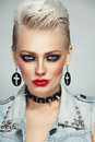 Beautiful platinum blond woman with 80s style makeup