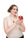 Beautiful plus size woman with apple Stock Photo