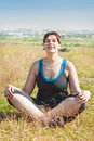 Beautiful plus size woman doing yoga outdoor in summer Royalty Free Stock Photos
