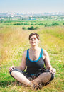 Beautiful plus size woman doing yoga outdoor in summer Royalty Free Stock Photography