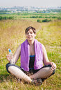 Beautiful plus size woman doing yoga outdoor in summer Stock Photo