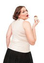 Beautiful plus size woman eating pastry isolated Royalty Free Stock Photo