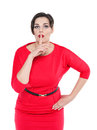 Beautiful plus size woman in red dress with finger on lips isola Royalty Free Stock Photo