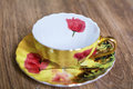Beautiful porcelain cup golden with red poppies Stock Photos