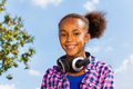 Beautiful portrait of african girl with headphones nice looking in summer during day Royalty Free Stock Image