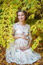Pregnant female in autumn Royalty Free Stock Photo