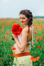 Beautiful pregnant girl in the poppy field Royalty Free Stock Photo