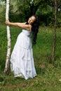 Beautiful pregnant girl walking in park Royalty Free Stock Photo
