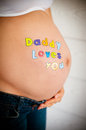 Beautiful pregnant model expecting newborn Royalty Free Stock Images