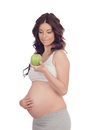 Beautiful pregnant woman with a apple isolated on white background Stock Images