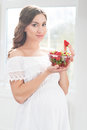 Beautiful pregnant woman with a bowl of strawberries Royalty Free Stock Photo