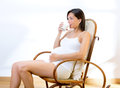 Beautiful pregnant woman drinking milk at home Royalty Free Stock Photo