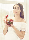 Beautiful pregnant woman eating strawberries in kitchen. Motherh Royalty Free Stock Photo