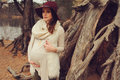 Beautiful pregnant woman in fashion hat on cozy warm outdoor walk riverside Stock Images