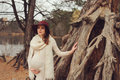 Beautiful pregnant woman in fashion hat on cozy warm outdoor walk riverside Stock Photography