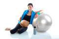Beautiful pregnant woman at fitness gym relaxed Royalty Free Stock Photography