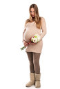Beautiful pregnant woman with flowers Stock Photos